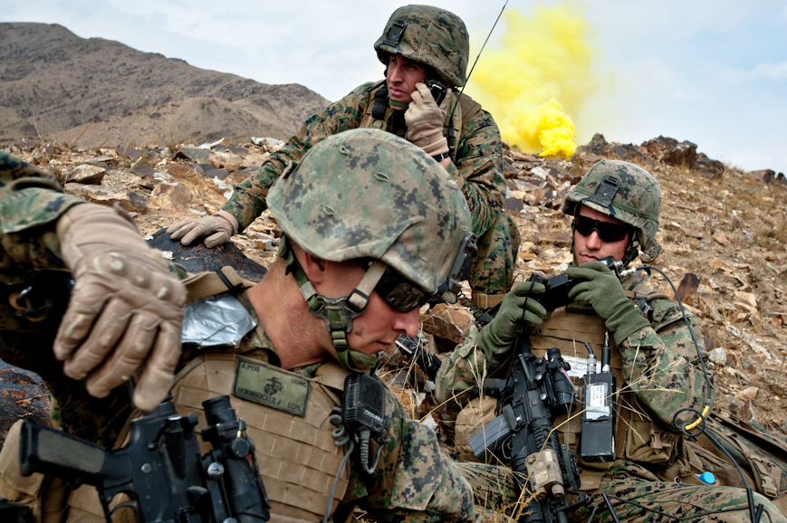 Marine Captain Maloney (far right) communicates with Army Special Forces and aircraft in the midst of a brief firefight with insurgents in the Depak Valley.