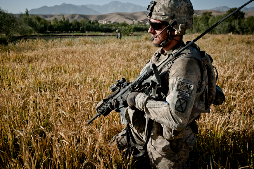 Twenty-four-year-old Lieutenant Mark Hogan, commander of Second Platoon Apache Company, wades through waist-high wheat fields in the Tangi Valley during a daily IED sweep.