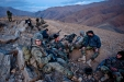 Marine Captain Ryan Maloney sits with Afghan National Army soldiers at a mountaintop bivouac site in the Depak Valley.