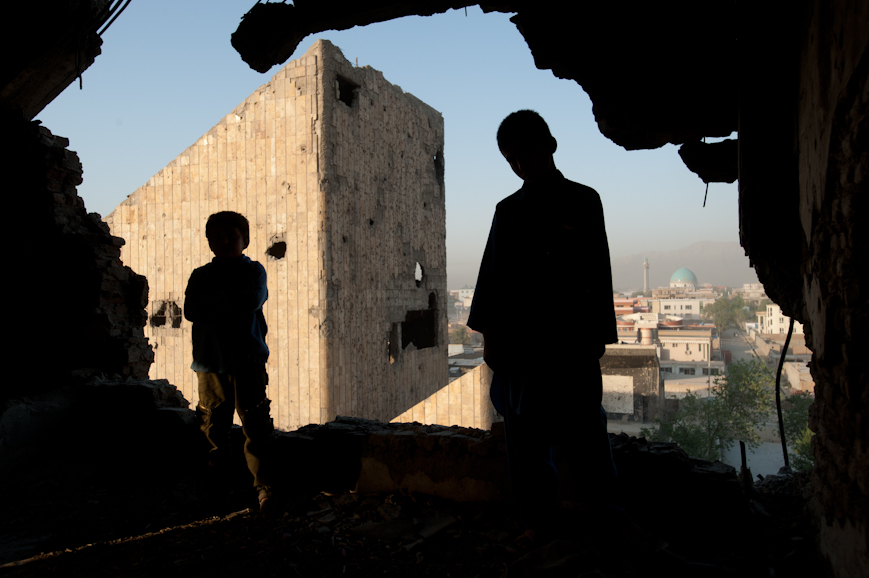 Sherifullah, 11, and Abdel Basit, 8, stand on one of the upper floors of the Russian Palace of Culture, which was heavily shelled during the mujahedin civil war that followed the Soviet withdrawal. Until recently, the bombed out buildings have sheltered homeless Afghans and heroin addicts.