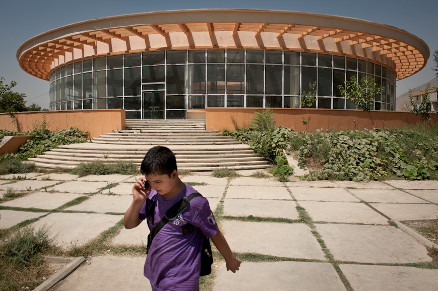 A student walks past the cafeteria at the Kabul Polytechnic University in Karte Mamourin. The USSR facilitated the construction of the institute in 1963 to provide high-level training for Afghan engineering students. The Polytechnic was heavily damaged during the Afghan civil war, but re-opened in 2003. Reconstruction efforts are underway, and the Polytechnic is once again a top destination for Afghan students.