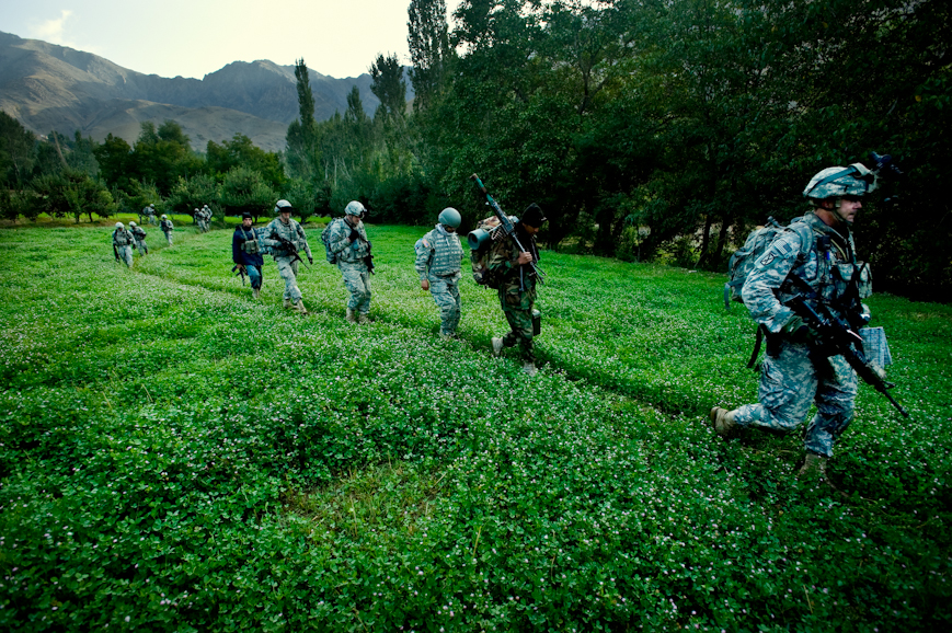 Soldiers from 4th Battalion 25th Field Artillery Regiment walk through a field of fodder in the Jalrez Valley, Wardak Province. The Jalrez Valley is well-irrigated and very fertile. Farmers there are famous all over the country for their apples.
