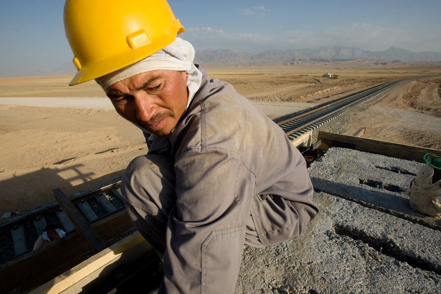 Nayzabad, Afghanistan: Uzbek workers build a signal station on the new railway spur between the northern Afghan city of Mazar-e-Sharif and Uzbekistan. July 2010.